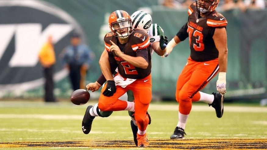 Sep 13, 2015; East Rutherford, NJ, USA; Cleveland Browns quarterback Johnny Manziel (2) fumbles the ball after getting sacked by New York Jets linebacker Trevor Reilly (57) during the second half at MetLife Stadium. Mandatory Credit: Danny Wild-USA TODAY Sports