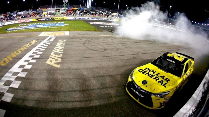 RICHMOND, VA - SEPTEMBER 12: Matt Kenseth, driver of the #20 Dollar General Toyota, celebrates with a burnout after winning the NASCAR Sprint Cup Series Federated Auto Parts 400 at Richmond International Raceway on September 12, 2015 in Richmond, Virginia. (Photo by Sarah Crabill/Getty Images)