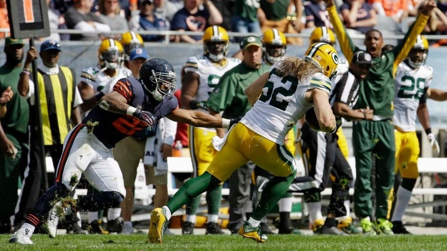 Green Bay Packers linebacker Clay Matthews runs after intercepting a pass intended for Chicago Bears running back Matt Forte during the second half of an NFL football game, Sunday, Sept. 13, 2015, in Chicago.