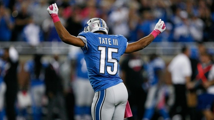 Oct 5, 2014; Detroit, MI, USA; Detroit Lions wide receiver Golden Tate (15) does a celebration dance after a big play during the fourth quarter against the Buffalo Bills at Ford Field. Bills beat the Lions 17-14. Mandatory Credit: Raj Mehta-USA TODAY Sports