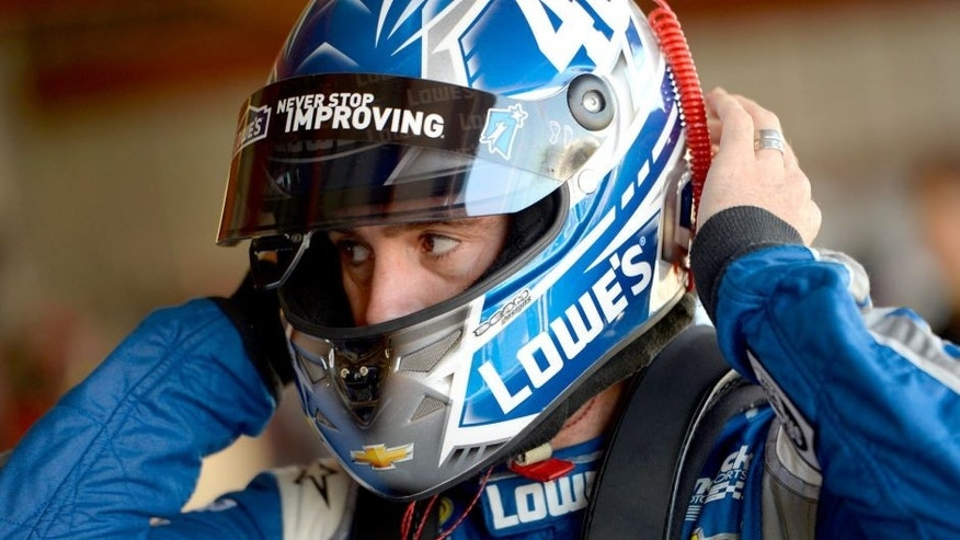 RICHMOND, VA - SEPTEMBER 11: Jimmie Johnson, driver of the #48 Lowe's Chevrolet, stands in the garage area during practice for the NASCAR Sprint Cup Series Federated Auto Parts 400 at Richmond International Raceway on September 11, 2015 in Richmond, Virginia. (Photo by Robert Laberge/Getty Images)