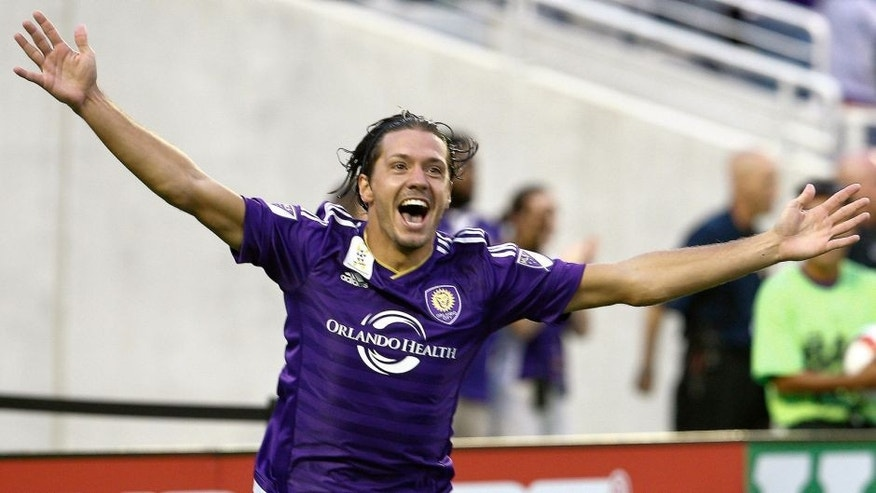 Sep 13, 2015; Orlando, FL, USA; Orlando City FC midfielder Adrian Winter (32) celebrates after scoring a goal during the first half of an MLS soccer game against the Sporting KC at Orlando Citrus Bowl Stadium. Mandatory Credit: Reinhold Matay-USA TODAY Sports