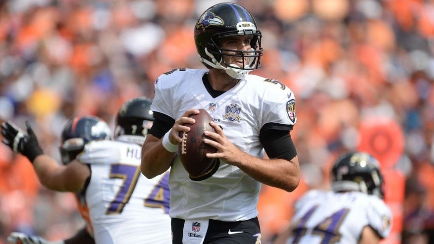 Sep 13, 2015; Denver, CO, USA; Baltimore Ravens quarterback Joe Flacco (5) prepares to pass the ball in the first quarter against the Baltimore Ravens at Sports Authority Field at Mile High. Mandatory Credit: Ron Chenoy-USA TODAY Sports