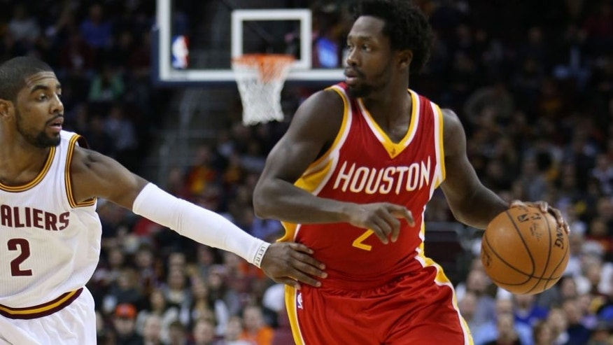 Jan 7, 2015; Cleveland, OH, USA; Houston Rockets guard Patrick Beverley (2) drives around Cleveland Cavaliers guard Kyrie Irving (2) during the second quarter at Quicken Loans Arena. Mandatory Credit: Ron Schwane-USA TODAY Sports