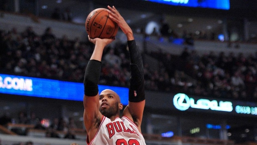 <p>Jan 27, 2014; Chicago, IL, USA; Chicago Bulls power forward Taj Gibson (22) shoots the ball against the Minnesota Timberwolves during the first quarter at the United Center.</p>