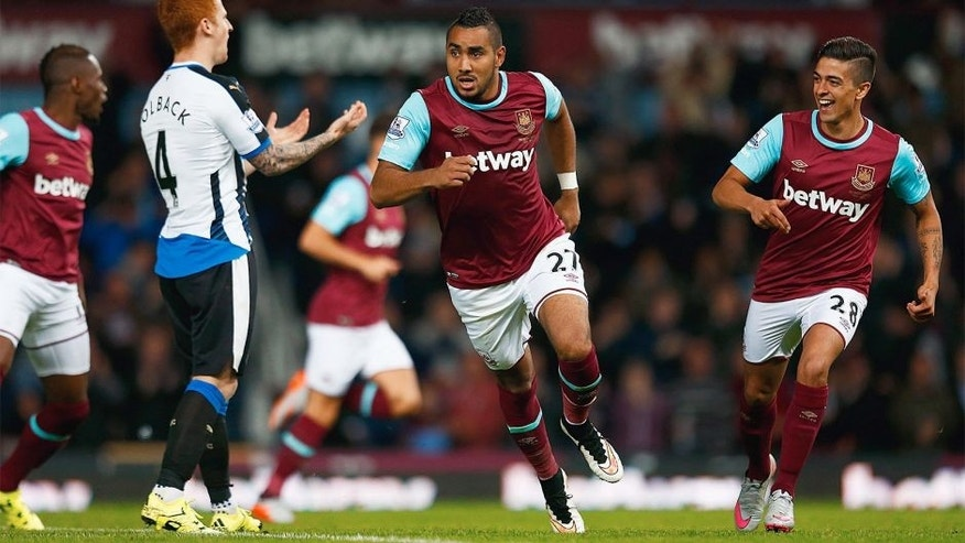 LONDON, ENGLAND - SEPTEMBER 14: Dimitri Payet of West Ham United celebrates scoring his second goal during the Barclays Premier League match between West Ham United and Newcastle United at the Boleyn Ground on September 14, 2015 in London, United Kingdom. (Photo by Julian Finney/Getty Images)