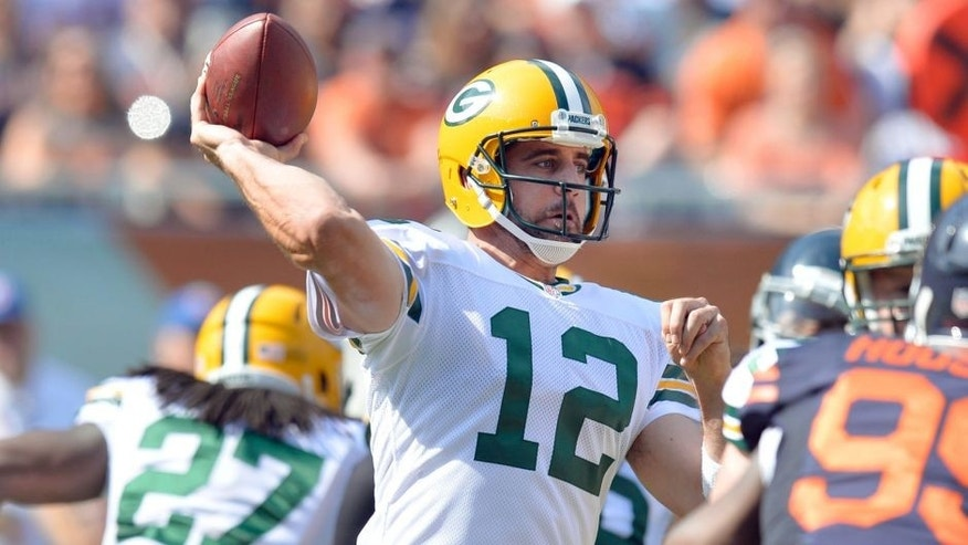 Quarterback Aaron Rodgers #12 of the Green Bay Packers passes during the second quarter against the Chicago Bears on September 28, 2014 at Soldier Field in Chicago, Illinois. The Packers defeated the Bears 38-17. (Photo by Brian D. Kersey/Getty Images)