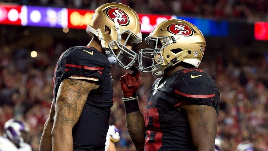 Sep 14, 2015; Santa Clara, CA, USA; San Francisco 49ers running back Carlos Hyde (28) celebrates with quarterback Colin Kaepernick (7) after scoring a touchdown against the Minnesota Vikings during the second quarter at Levi's Stadium. Mandatory Credit: Kelley L Cox-USA TODAY Sports