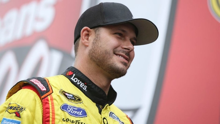David Gilliland, driver of the #38 Love's Travel Stops Ford, greets fans during the NASCAR Sprint Cup Series Quicken Loans 400 at Michigan International Speedway on June 14, 2015 in Brooklyn, Michigan.
