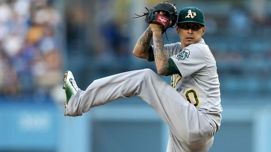 <p>LOS ANGELES, CA - JULY 29: Jesse Chavz #30 of the Oakland Athletics throws a pitch against the Los Angeles Dodgers at Dodger Stadium on July 29, 2015 in Los Angeles, California. (Photo by Stephen Dunn/Getty Images)</p>