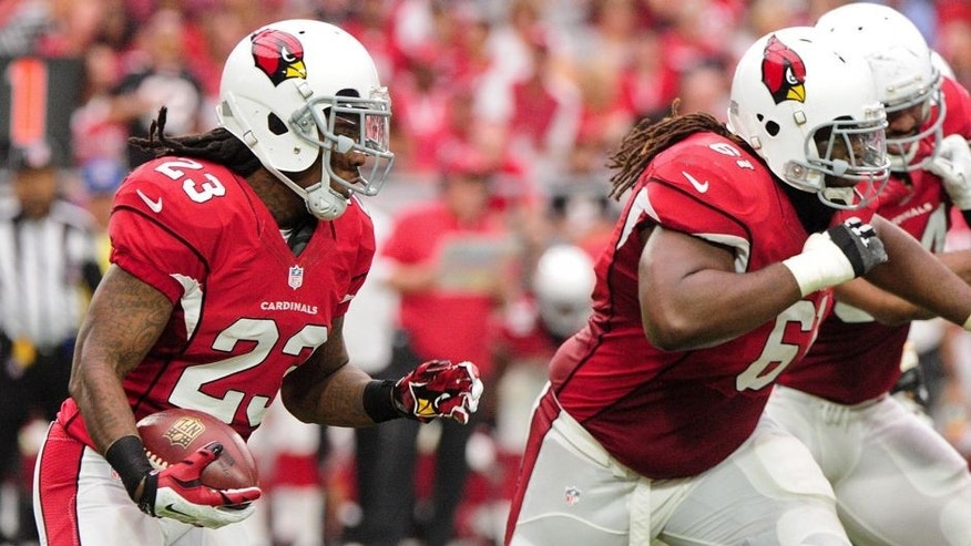 Sep 13, 2015; Glendale, AZ, USA; Arizona Cardinals running back Chris Johnson (23) carries the ball behind guard Jonathan Cooper (61) during the first half against the New Orleans Saints at University of Phoenix Stadium. Mandatory Credit: Matt Kartozian-USA TODAY Sports