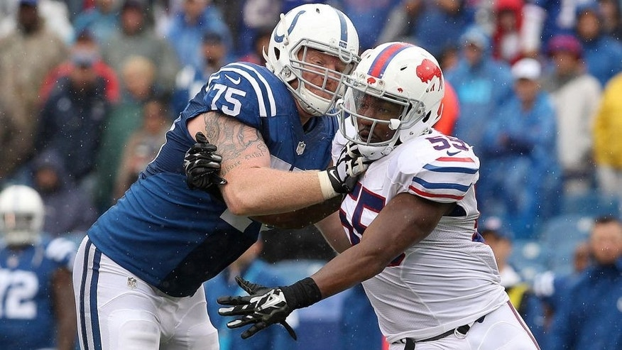 Sep 13, 2015; Orchard Park, NY, USA; Indianapolis Colts guard Jack Mewhort (75) tries to block Buffalo Bills defensive end Jerry Hughes (55) during the second half at Ralph Wilson Stadium. Bills beat the Colts 27 to 14. Mandatory Credit: Timothy T. Ludwig-USA TODAY Sports