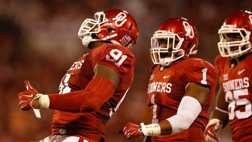 Sep 13, 2014; Norman, OK, USA; Oklahoma Sooners defensive end Charles Tapper (91) and linebacker Dominique Alexander (1) react during the game against the Tennessee Volunteers at Gaylord Family - Oklahoma Memorial Stadium. Mandatory Credit: Kevin Jairaj-USA TODAY Sports