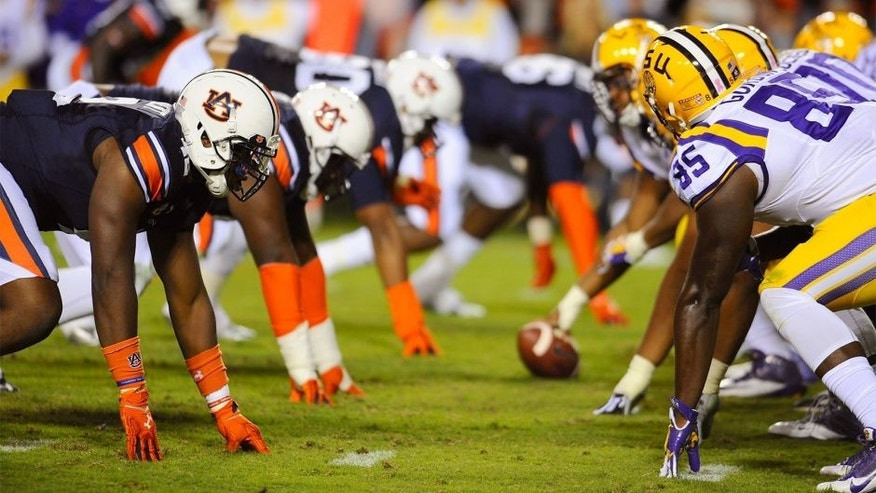 Oct 4, 2014; Auburn, AL, USA; Auburn Tigers and LSU Tigers at the line of scrimmage during the second half at Jordan Hare Stadium. Auburn won 41-7. Mandatory Credit: Shanna Lockwood-USA TODAY Sports