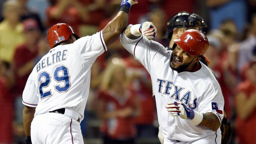 Texas Rangers' Adrian Beltre (29) and Prince Fielder, right, celebrate Fielder's two-run home run that scored Beltre in the eighth inning of a baseball game against the Houston Astros Monday, Sept. 14, 2015, in Arlington, Texas. The Rangers won 5-3. (AP Photo/Jeffrey McWhorter)