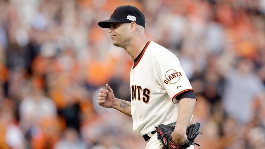 SAN FRANCISCO, CA - OCTOBER 24: Tim Hudson #17 of the San Francisco Giants reacts in the second inning while taking on the Kansas City Royals during Game Three of the 2014 World Series at AT&T Park on October 24, 2014 in San Francisco, California. (Photo by Ezra Shaw/Getty Images)