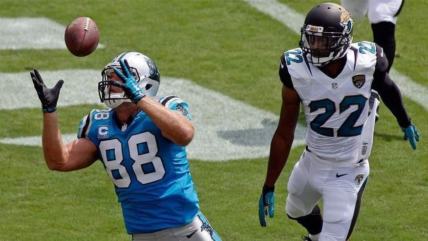 Sep 13, 2015; Jacksonville, FL, USA; Carolina Panthers tight end Greg Olsen (88) catches a pass in the end zone as Jacksonville Jaguars cornerback Aaron Colvin (22) watches in the first quarter of their game at EverBank Field. The touchdown was nullified as Olson was penalized for offensive interference. Mandatory Credit: Phil Sears-USA TODAY Sports