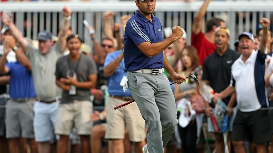 FILE - In this Aug. 30, 2015, file photo, Jason Day, of Australia, reacts after making a birdie putt on the 15th green during the final round of play at The Barclays golf tournament in Edison, N.J. Combine talent, work ethic and — finally — self-belief, and the Australian has emerged as a force. (AP Photo/Adam Hunger, File)