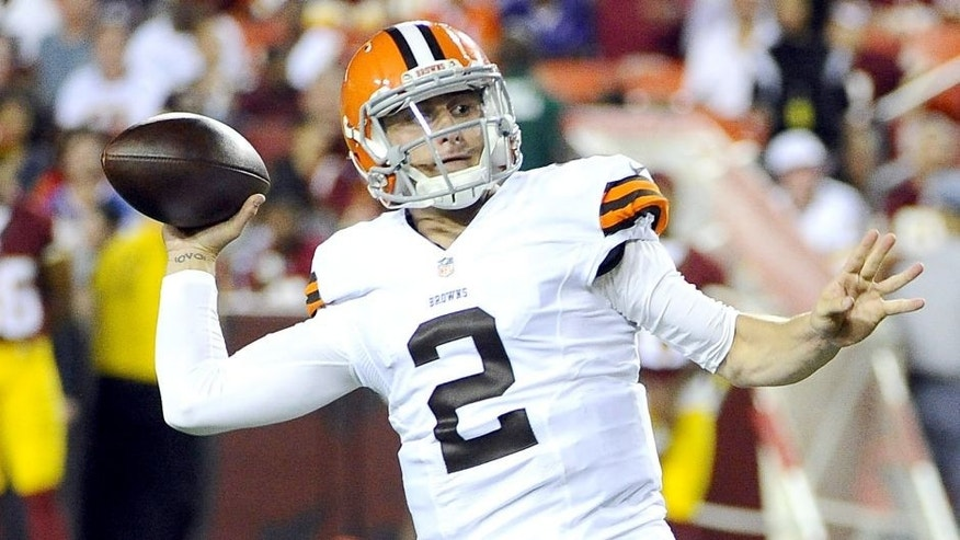 <p>Aug 18, 2014; Landover, MD, USA; Cleveland Browns quarterback Johnny Manziel (2) throws a pass as Washington Redskins linebacker Trent Murphy (93) pressures during the second half at FedEx Field.</p>