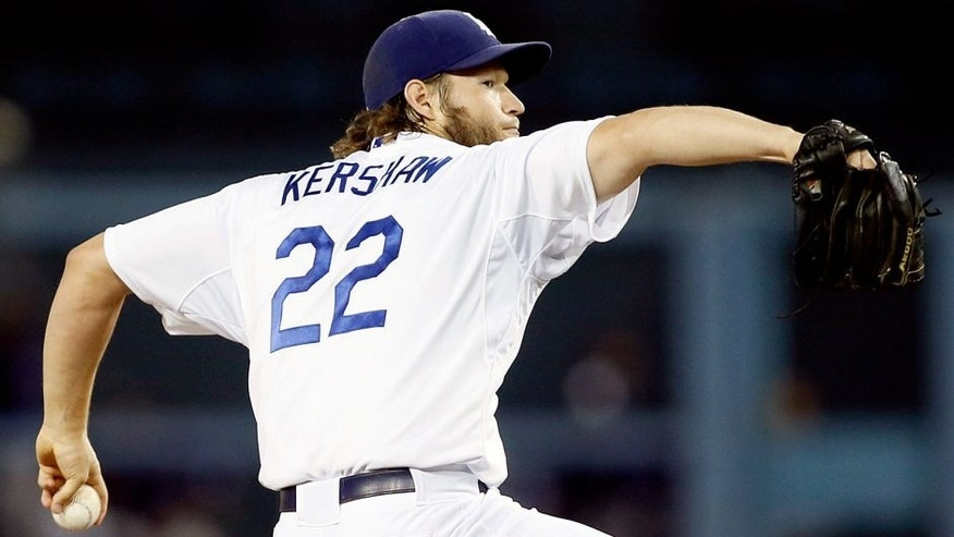 Los Angeles Dodgers starting pitcher Clayton Kershaw delivers against the Colorado Rockies during the first inning of a baseball game, Monday, Sept. 14, 2015, in Los Angeles. (AP Photo/Danny Moloshok)