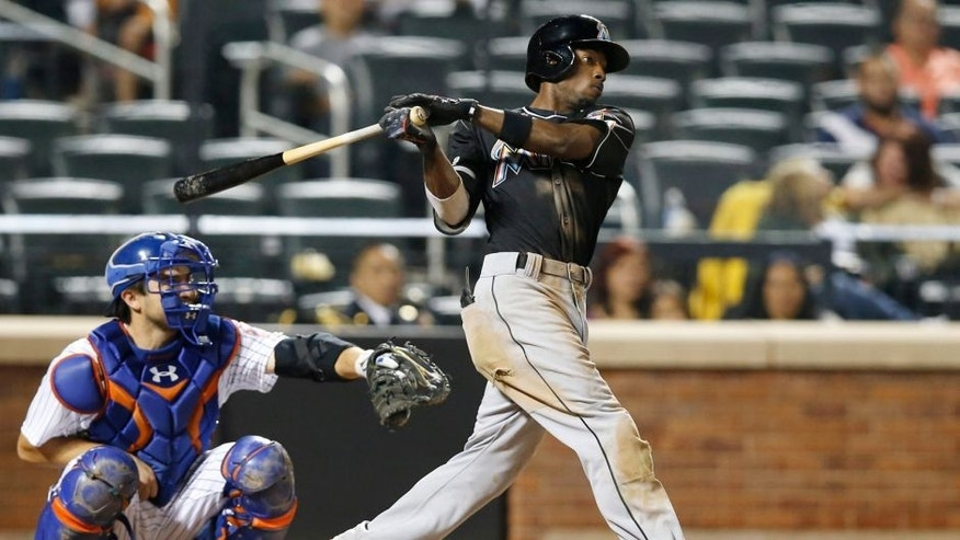 Miami Marlins' Dee Gordon hits a ninth-inning, two-run home run off New York Mets relief pitcher Dario Alvarez during a baseball game in New York, Tuesday, Sept. 15, 2015. (AP Photo/Kathy Willens)