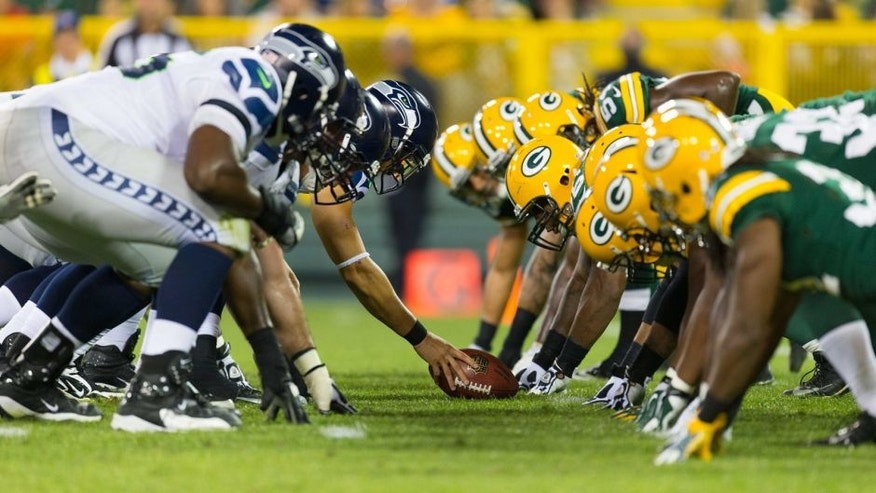 <p>Aug 23, 2013; Green Bay, WI, USA; The Seattle Seahawks line up for a play during the game against the Green Bay Packers at Lambeau Field. Seattle won 17-10.  </p>