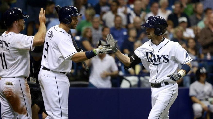 <p>Sep 15, 2015; St. Petersburg, FL, USA; Tampa Bay Rays second baseman Nick Franklin (2) is congratulated by first baseman James Loney (21) and second baseman Logan Forsythe (11) after he hits a 2-run home run during the sixth inning against the New York Yankees at Tropicana Field. Mandatory Credit: Kim Klement-USA TODAY Sports</p>