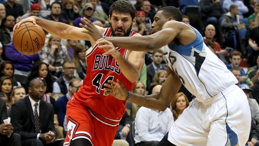 <p>Nov 1, 2014; Minneapolis, MN, USA; Chicago Bulls forward Nikola Mirotic (44) drives past Minnesota Timberwolves forward Thaddeus Young (33) during the second quarter at Target Center. Mandatory Credit: Brace Hemmelgarn-USA TODAY Sports</p>