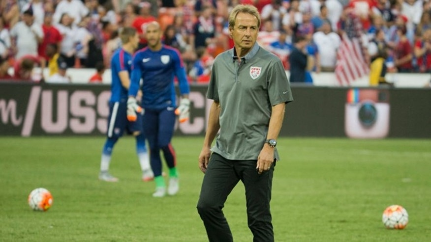 U.S. head soccer coach Jürgen Klinsmann watches his players warm up prior to start of an international friendly soccer match against Peru, Friday, Sept. 4, 2015 at RFK Stadium in Washington. (AP Photo/Pablo Martinez Monsivais)