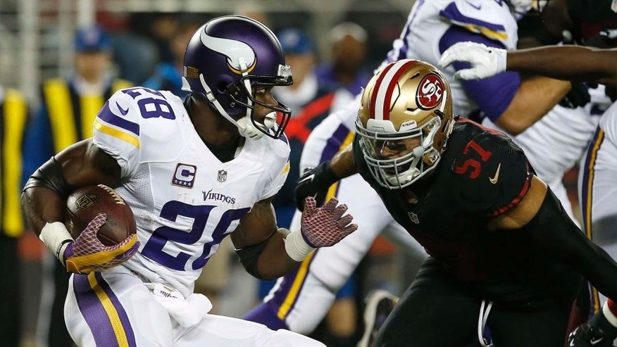 Minnesota Vikings running back Adrian Peterson runs against San Francisco 49ers linebacker Michael Wilhoite during the first half of an NFL football game in Santa Clara, Calif., Monday, Sept. 14, 2015.