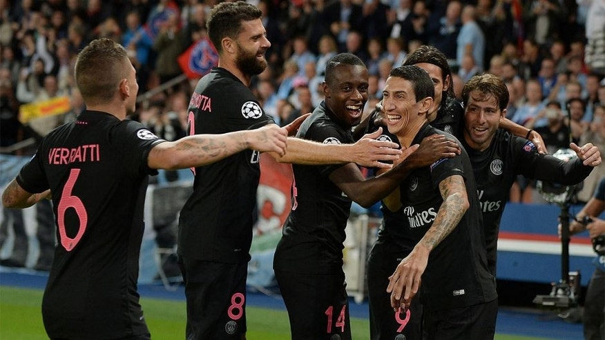 Paris Saint-Germain's Argentinian forward Angel Di Maria (2nd R) celebrates with teammates after scoring a goal during the UEFA Champions League group A football match between Paris Saint Germain (PSG) and Malmo FF on September 15, 2015 at the Parc des Princes stadium in Paris. AFP PHOTO / JEAN-SEBASTIEN EVRARD (Photo credit should read JEAN-SEBASTIEN EVRARD/AFP/Getty Images)