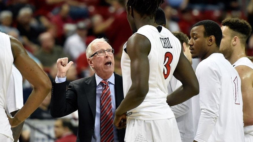 LAS VEGAS, NV - MARCH 13: Head coach Steve Fisher of the San Diego State Aztecs speaks with his players during a semifinal game of the Mountain West Conference basketball tournament against the Colorado State Rams at the Thomas & Mack Center on March 13, 2015 in Las Vegas, Nevada. San Diego State won 56-43. (Photo by David Becker/Getty Images)