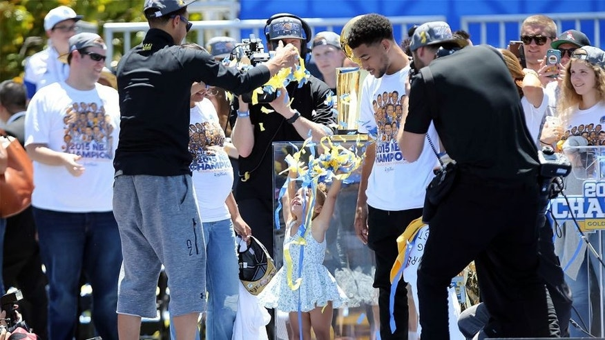 Jun 19, 2015; Oakland, CA, USA; Riley Curry throws up streamer confetti during the Golden State Warriors 2015 championship celebration at the Henry J. Kaiser Convention Center. Mandatory Credit: Kelley L Cox-USA TODAY Sports