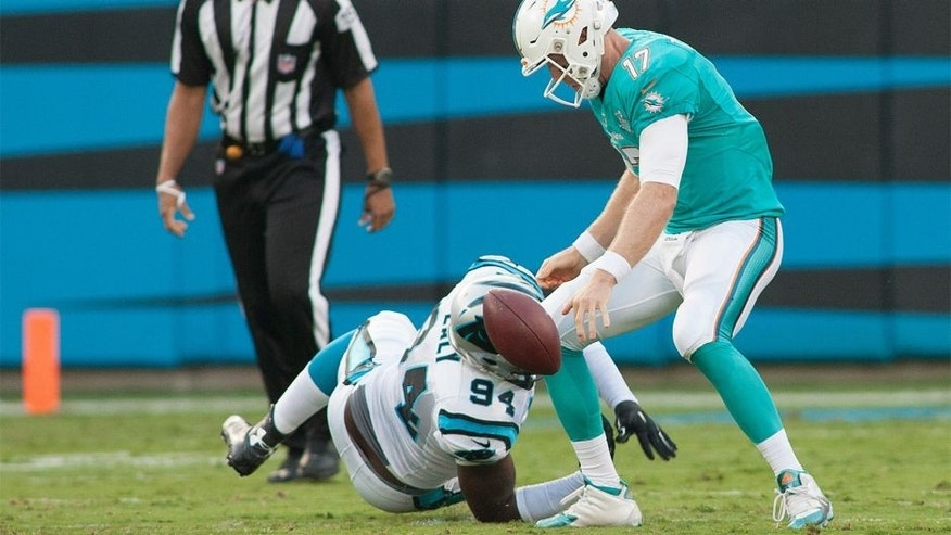 Aug 22, 2015; Charlotte, NC, USA; Carolina Panthers defensive end Kony Ealy (94) knocks the ball loose from Miami Dolphins quarterback Ryan Tannehill (17) during the first quarter at Bank of America Stadium. Mandatory Credit: Jeremy Brevard-USA TODAY Sports