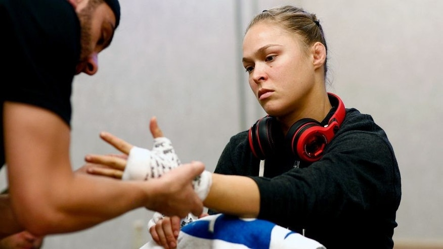 LAS VEGAS, NV - JULY 05: UFC Women's Bantamweight Champion Ronda Rousey gets her hands wrapped before her championship fight with Alexis Davis at UFC 175 inside the Mandalay Bay Events Center on July 5, 2014 in Las Vegas, Nevada. (Photo by Esther Lin/Zuffa LLC/Zuffa LLC via Getty Images)