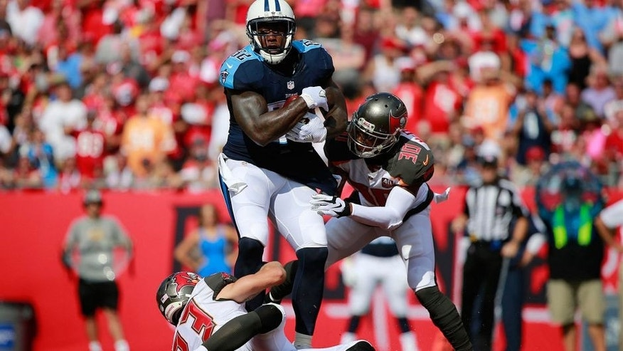 Sep 13, 2015; Tampa, FL, USA;Tennessee Titans tight end Delanie Walker (82) runs with the ball as Tampa Bay Buccaneers defensive back Chris Conte (23) and strong safety Bradley McDougald (30) attempt to defend during the first quarter at Raymond James Stadium. Mandatory Credit: Kim Klement-USA TODAY Sports