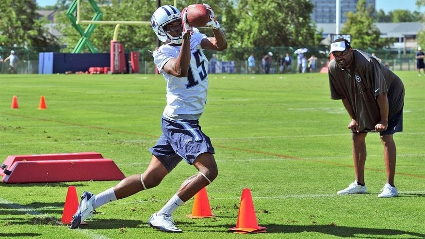 Jul 31, 2015; Nashville, TN, USA; Tennessee Titans wide receiver Justin Hunter (15) catches a pass during drills as wide receiver coach Shawn Jefferson observes on the first day of training camp at Saint Thomas Sports Park. Mandatory Credit: Jim Brown-USA TODAY Sports