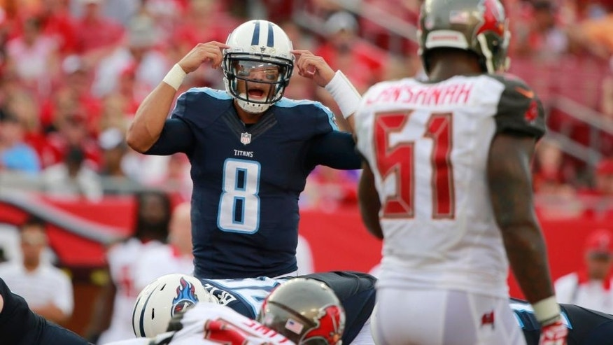 Sep 13, 2015; Tampa, FL, USA; Tennessee Titans quarterback Marcus Mariota (8) calls a play against the Tampa Bay Buccaneers during the second half at Raymond James Stadium. Tennessee Titans defeated the Tampa Bay Buccaneers 42-14. Mandatory Credit: Kim Klement-USA TODAY Sports