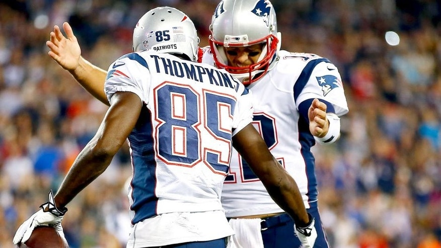 FOXBORO, MA - AUGUST 15: Tom Brady #12 celebrates with teammmate Kenbrell Thompkins #85 of the New England Patriots following their touchdown in the first quarter against the Philadelphia Eagles during the preseason game at Gillette Stadium on August 15, 2014 in Foxboro, Massachusetts. (Photo by Jared Wickerham/Getty Images)