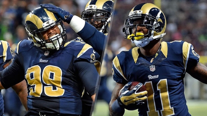 St. Louis Rams defensive tackle Aaron Donald (99) celebrates with teammates after sacking Seattle Seahawks quarterback Russell Wilson (not pictured) during the second half at the Edward Jones Dome. Mandatory Credit: Jasen Vinlove-USA TODAY Sports St. Louis Rams wide receiver Tavon Austin (11) scores a touch down against the Seattle Seahawks during the first half at the Edward Jones Dome. Mandatory Credit: Jasen Vinlove-USA TODAY Sports