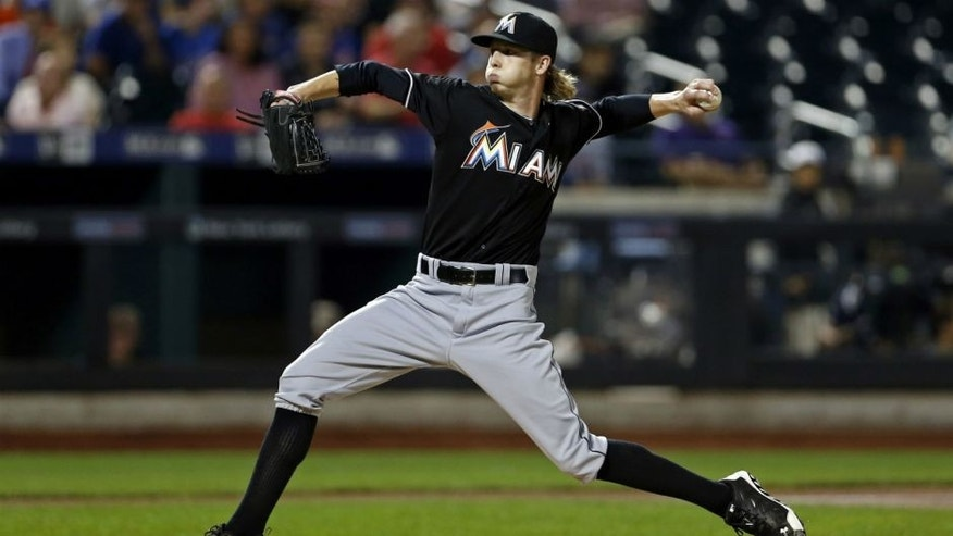 <p>Sep 16, 2015; New York City, NY, USA; Miami Marlins pitcher Adam Conley (61) pitches against the New York Mets during the second inning at Citi Field. Mandatory Credit: Adam Hunger-USA TODAY Sports</p>