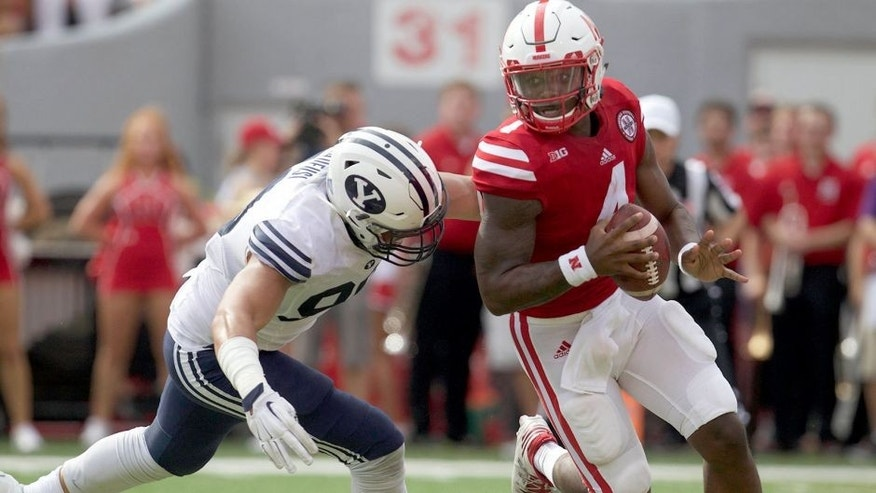 Sep 5, 2015; Lincoln, NE, USA; Brigham Young Cougars defender Bronson Kaufusi (90) sacks Nebraska Cornhuskers quarterback Tommy Armstrong Jr. in the first half at Memorial Stadium. Mandatory Credit: Bruce Thorson-USA TODAY Sports