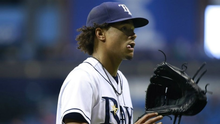 <p>Sep 16, 2015; St. Petersburg, FL, USA; Tampa Bay Rays starting pitcher Chris Archer (22) reacts as he walks back to the dugout at the end of the sixth inning against the New York Yankees at Tropicana Field. Mandatory Credit: Kim Klement-USA TODAY Sports</p>
