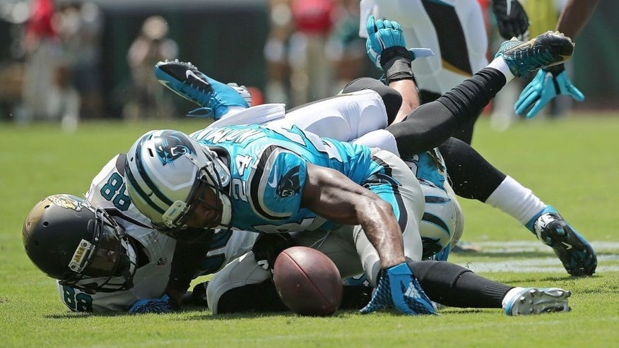 JACKSONVILLE, FL - SEPTEMBER 13: Josh Norman #24 of the Carolina Panthers recovers a fumble by Allen Hurns #88 of the Jacksonville Jaguars during a game at EverBank Field on September 13, 2015 in Jacksonville, Florida. (Photo by Mike Ehrmann/Getty Images)