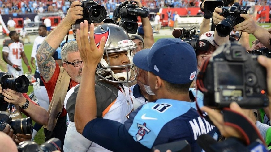 Sep 13, 2015; Tampa, FL, USA; Tampa Bay Buccaneers quarterback Jameis Winston (3) and Tennessee Titans quarterback Marcus Mariota (8) hug after their game at Raymond James Stadium. The Titans defeated the Buccaneers 42-14. Mandatory Credit: Jonathan Dyer-USA TODAY Sports