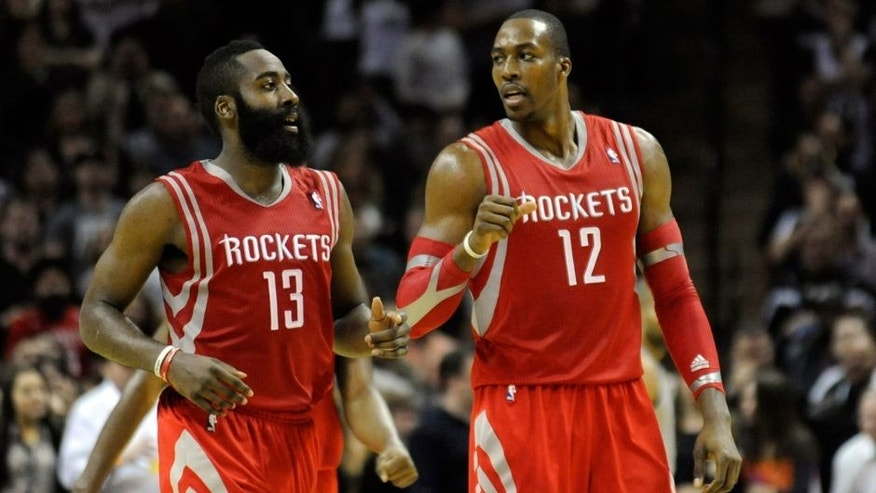 Nov 30, 2013; San Antonio, TX, USA; Houston Rockets guard James Harden (13) and forward Dwight Howard (12) react against the San Antonio Spurs during the second half at the AT&T Center. Houston beat San Antonio 112-106. Mandatory Credit: Brendan Maloney-USA TODAY Sports