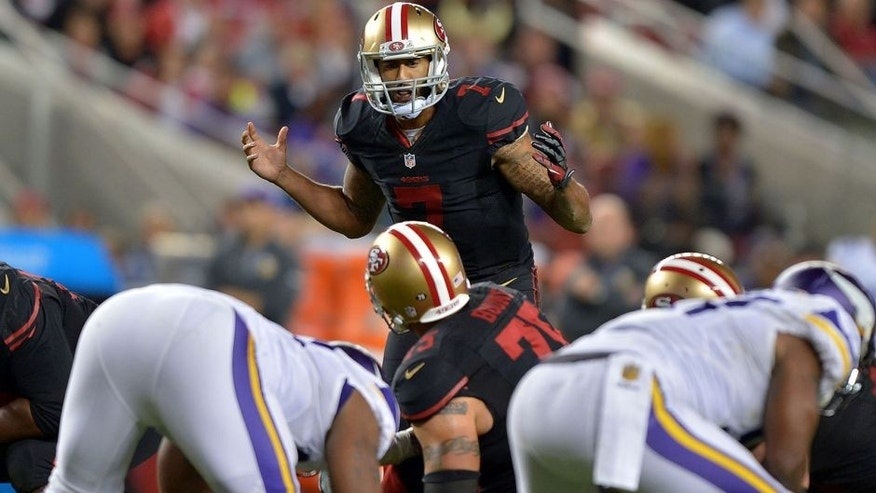 Sep 14, 2015; Santa Clara, CA, USA; San Francisco 49ers quarterback Colin Kaepernick (7) reacts at the line of scrimmage against the Minnesota Vikings at Levi's Stadium. Mandatory Credit: Kirby Lee-USA TODAY Sports