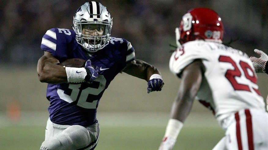 Sep 5, 2015; Manhattan, KS, USA; Kansas State Wildcats running back Justin Silmon (32) looks for room to run against South Dakota Coyotes defensive back Isaac Armstead (29) during the Wildcats' 34-0 win at Bill Snyder Family Football Stadium. Mandatory Credit: Scott Sewell-USA TODAY Sports
