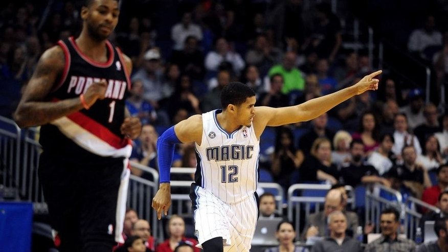 Mar 25, 2014; Orlando, FL, USA; Orlando Magic forward Tobias Harris (12) celebrates after hitting a three-point basket in the second half as the Orlando Magic beat the Portland Trail Blazers 95-85 at Amway Center. Harris scored a game-high 25 points. Mandatory Credit: David Manning-USA TODAY Sports