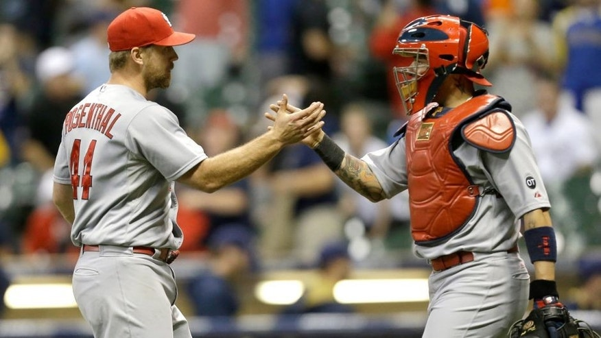 MILWAUKEE, WI - SEPTEMBER 15: Trevor Rosenthal #44 of the St. Louis Cardinals celebrates with Yadier Molina #4 after a 3-1 win over the Milwaukee Brewers at Miller Park on September 15, 2015 in Milwaukee, Wisconsin. (Photo by Mike McGinnis/Getty Images)